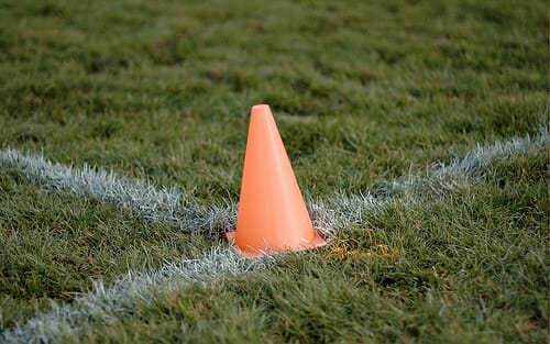 An orange cone marking the corner of an endzone.