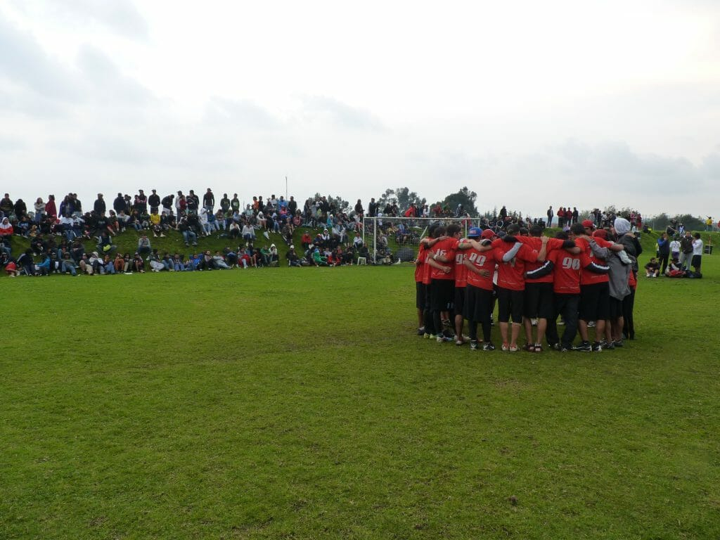 Euforia talks during a timeout as spectators look on at the 2012 Colombian Ultimate Nationals.