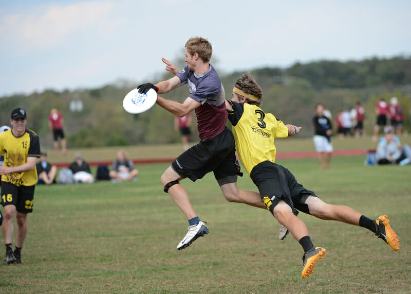 Truck Stop's Sean Keegan catches the disc in front of a diving Southpaw defender.