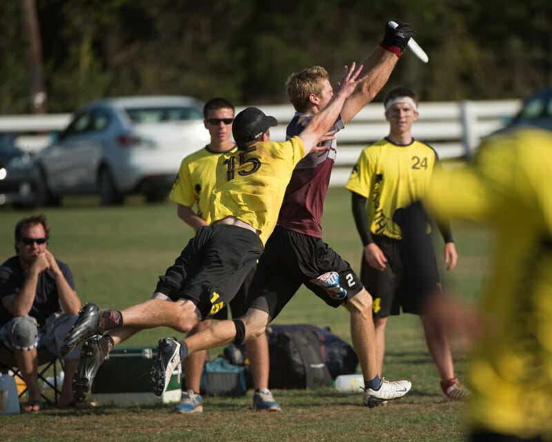 Truck Stop's Sean Keegan catches the disc in front of Southpaw's Greg Owens.