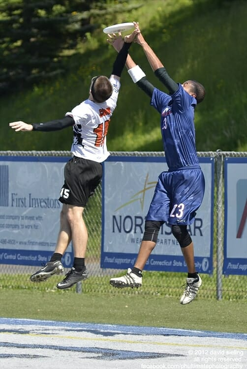The Connecticut Constitution's John Korber catches a hammer over his Rhode Island Rampage defender in an American Ultimate Disc League game.