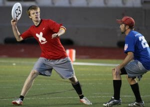 NexGen's Phillip Haas with the disc, playing against Boulder's Johnny Bravo.