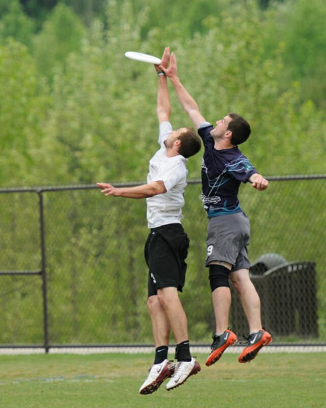 A UNC - Wilmington player grabs the disc at the 2012 Atlantic Coast Regionals.