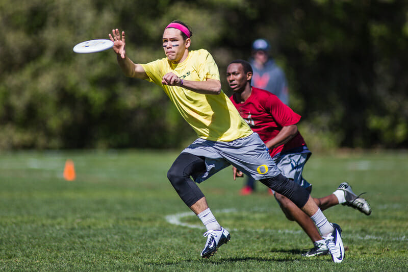 Oregon's Aaron Honn catches the disc against Carleton at the 2013 Stanford Invite.