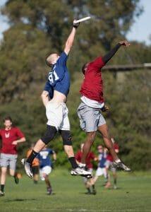 Pittsburgh's Tyler Degirolamo gets up against Carleton's Jesse Bolton at the Stanford Invite.