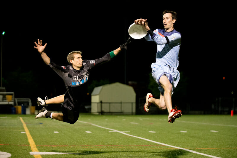 Philadelphia Spinner Matt Glazer catches the disc past diving DC Current player Erik Salmi.