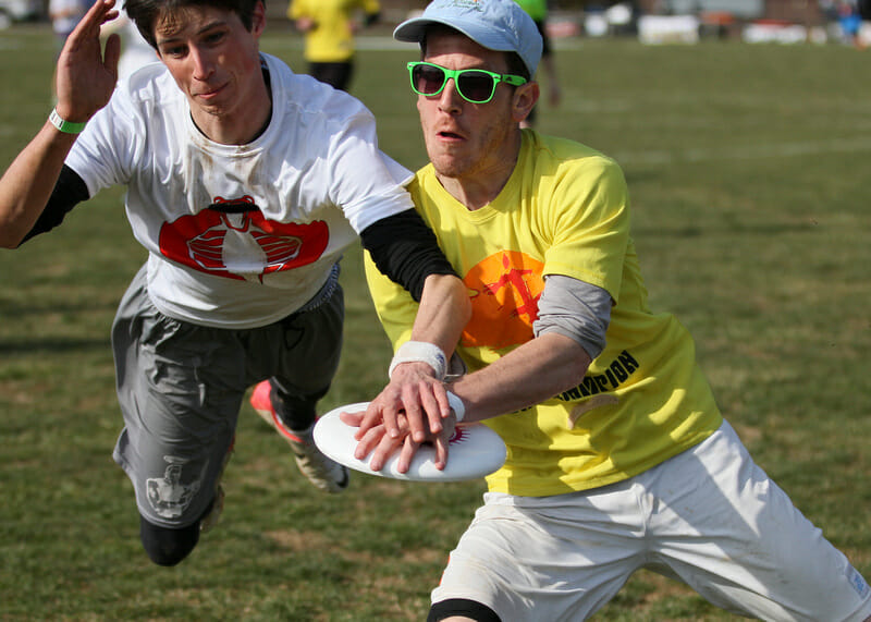 Two players go for the disc at the 2013 Fools Fest.