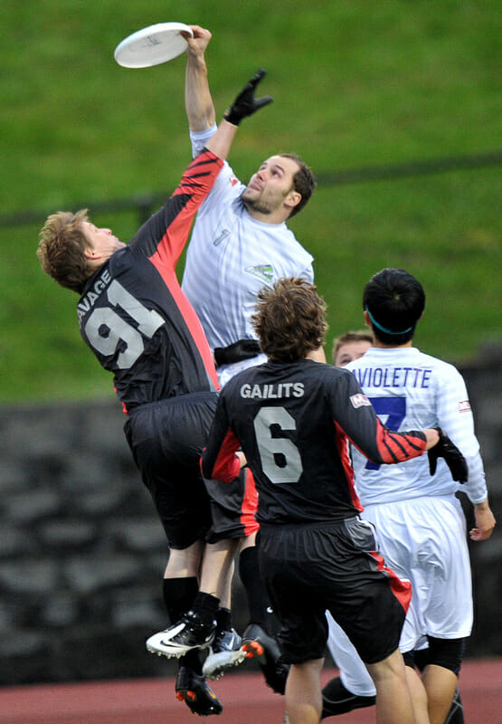 Rainmakers' Donny Clark grabs a greatest for a score against the Vancouver Nighthawks.