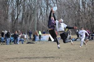UNI's Ryne Stajcar gets up over the defender.
