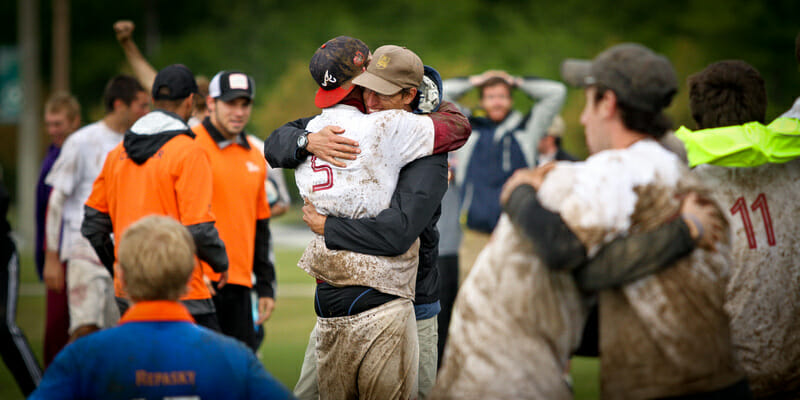 Florida State coach Peter van de Burgt embraces a player after they defeated Florida to make it to Nationals.