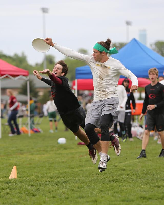 Oregon's Aaron Honn grabs the disc past a Georgia defender.