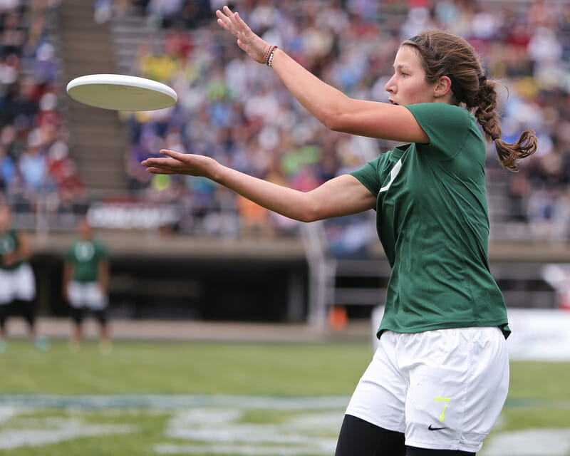 Oregon's Alex Ode catches the disc in front of the Madison crowd.