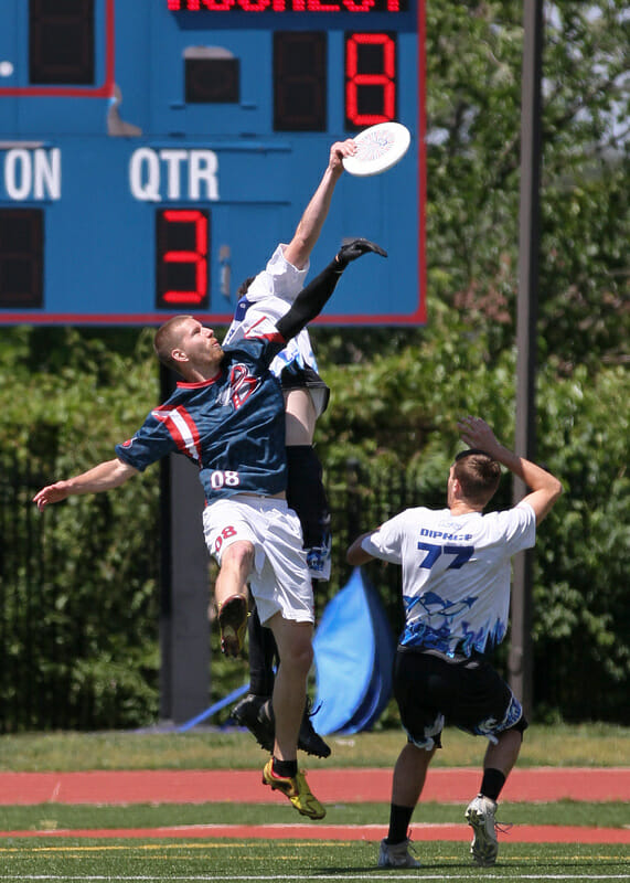 A Rochester Dragons player gets way up against the DC Breeze.