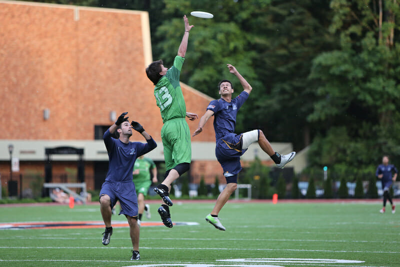 The Portland Stags' Timmy Perston goes up for the grab between two San Francisco Dogfish defenders.