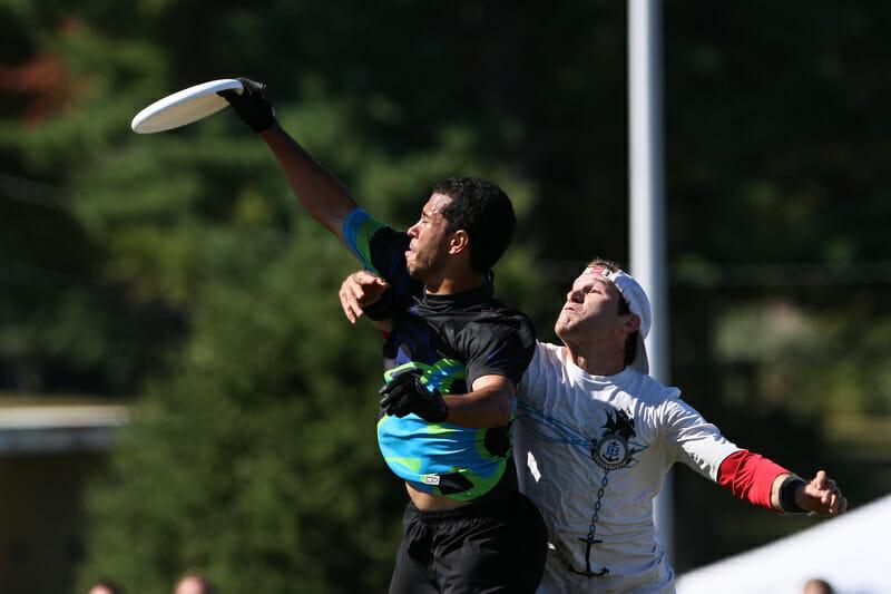 Toronto GOAT's Karl Loiseau grabs the disc past a Boston Ironside defender.
