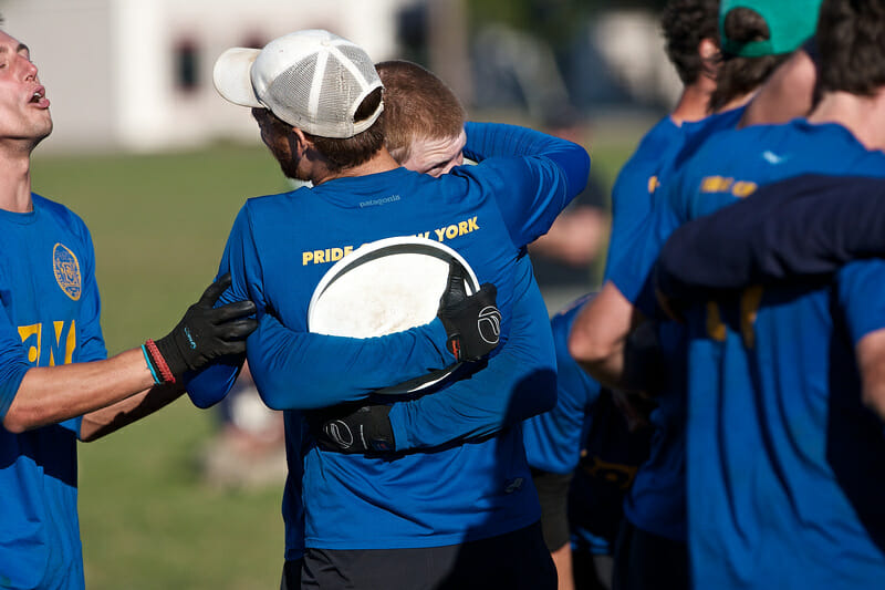 PoNY's Chris Mazur hugs a teammate after catching the game-winning score against Garuda.