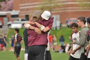 Tiina Booth hugs a player.