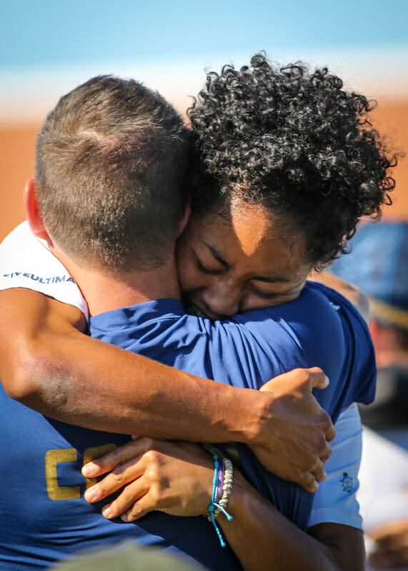 Scandal coach Alex Ghesquiere and captain Octavia 'Opi' Payne embrace after winning the 2013 Club Championships.