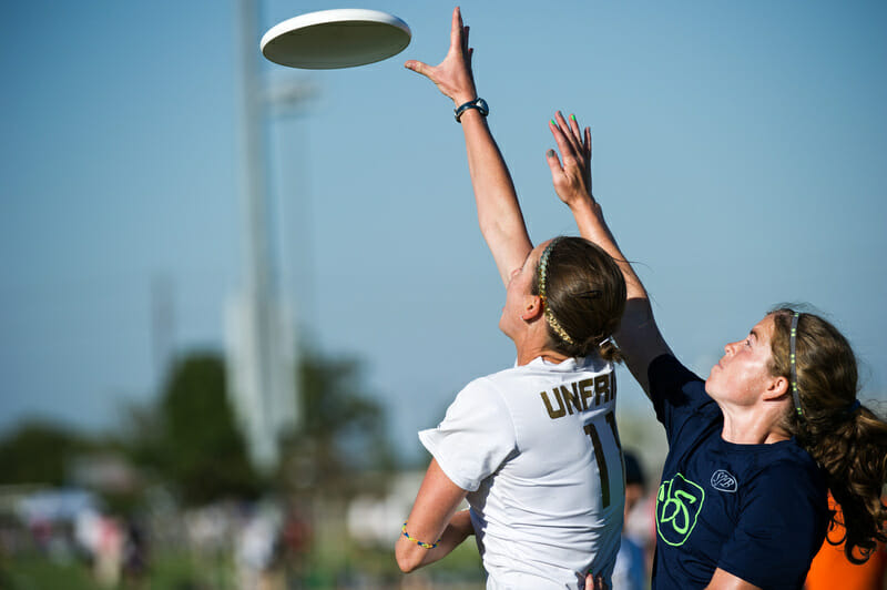 Scandal's Kirsten Unfried wins a race to the disc against Brute Squad