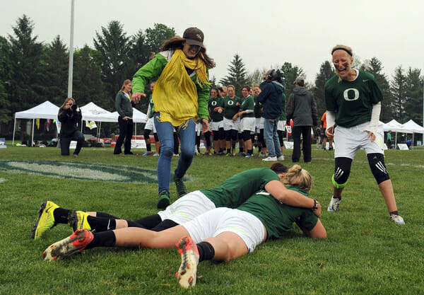 Oregon players embrace after winning the 2013 College National Championships.