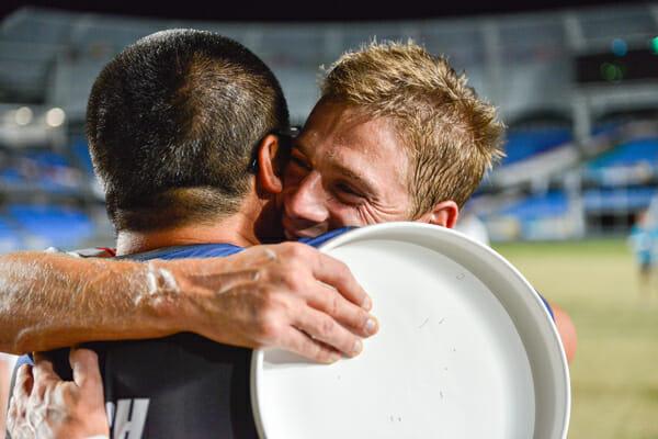 Ryan Farrell (right) and coach Matt Tsang embrace after Team USA won gold at the 2013 World Games. Photo: CBMT Creative.
