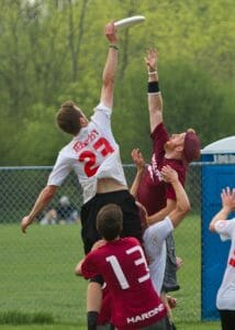 A Puget Sound player rises above the Harding defender at the 2013 D-III National Championships.