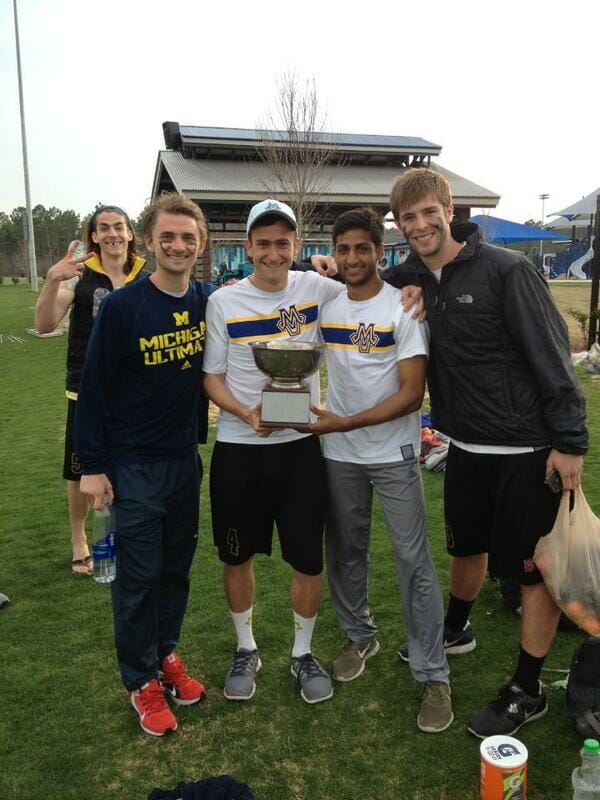 Michigan MagnUM players hold the 2014 Easterns trophy.