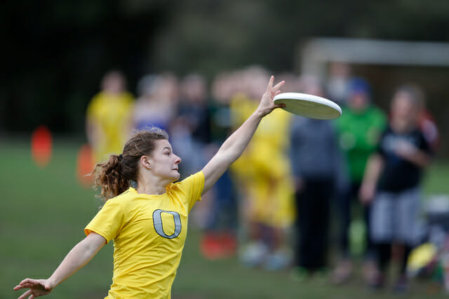 An Oregon player reaches for the disc at the 2014 Stanford Invite.