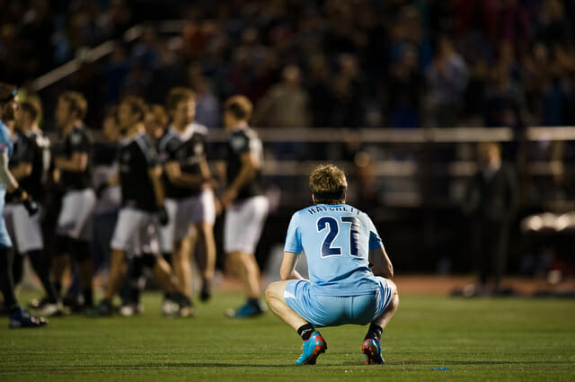 The Boston Whitecaps' Jack Hatchett looks on as the DC Current celebrate their win.