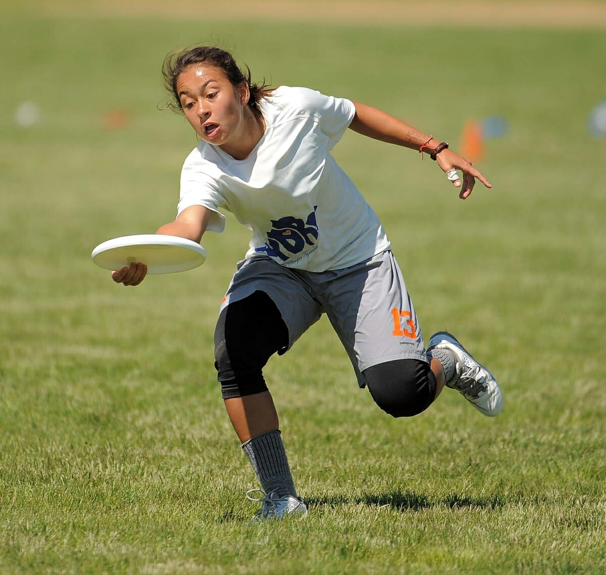 Virginia's Alika Johnston grabs the disc at the 2014 College Championships.