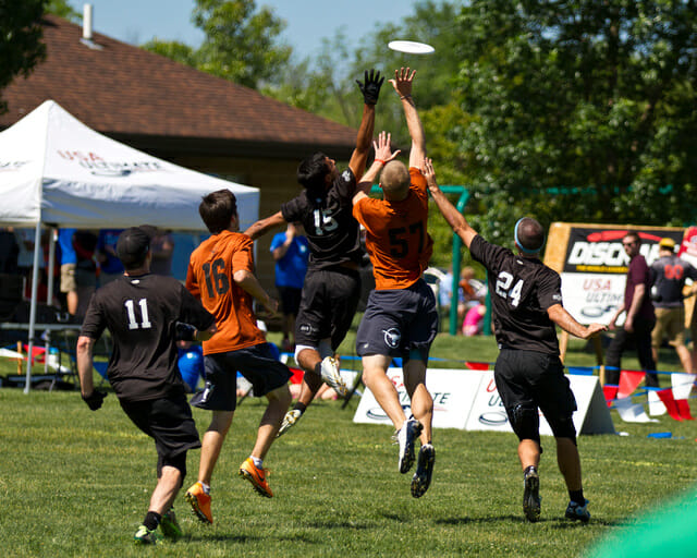 Texas' Will Driscoll goes up between a pair of UNC defenders at the 2014 College Championships.