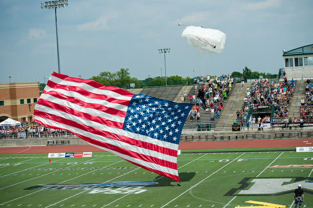 A skydiver lands on the field at the 2014 College Championships.