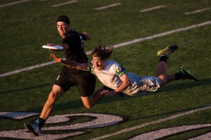 Jon Nethercutt grabs the disc past a bidding UNC Wilmington defender in the semifinals of the 2014 College Championships.