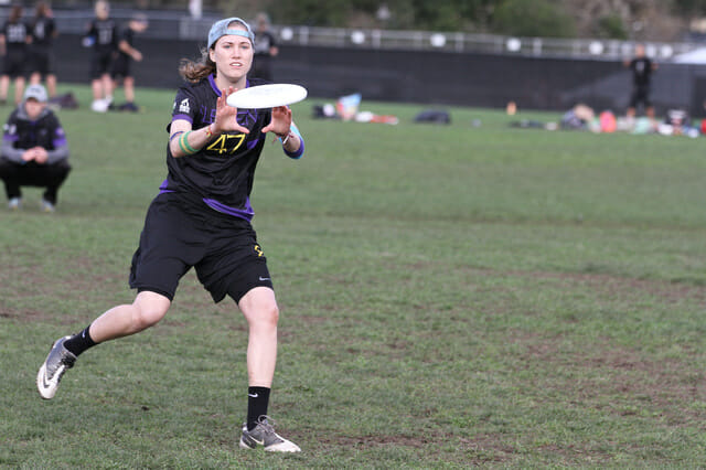 Washington's Amanda Kostic attacks the disc
