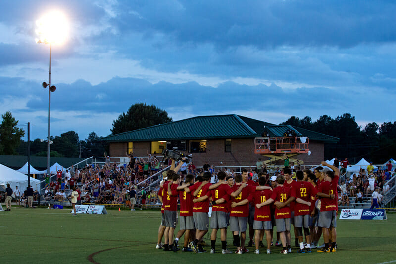 Revolver huddles up in front of the crowd at the 2013 US Open.