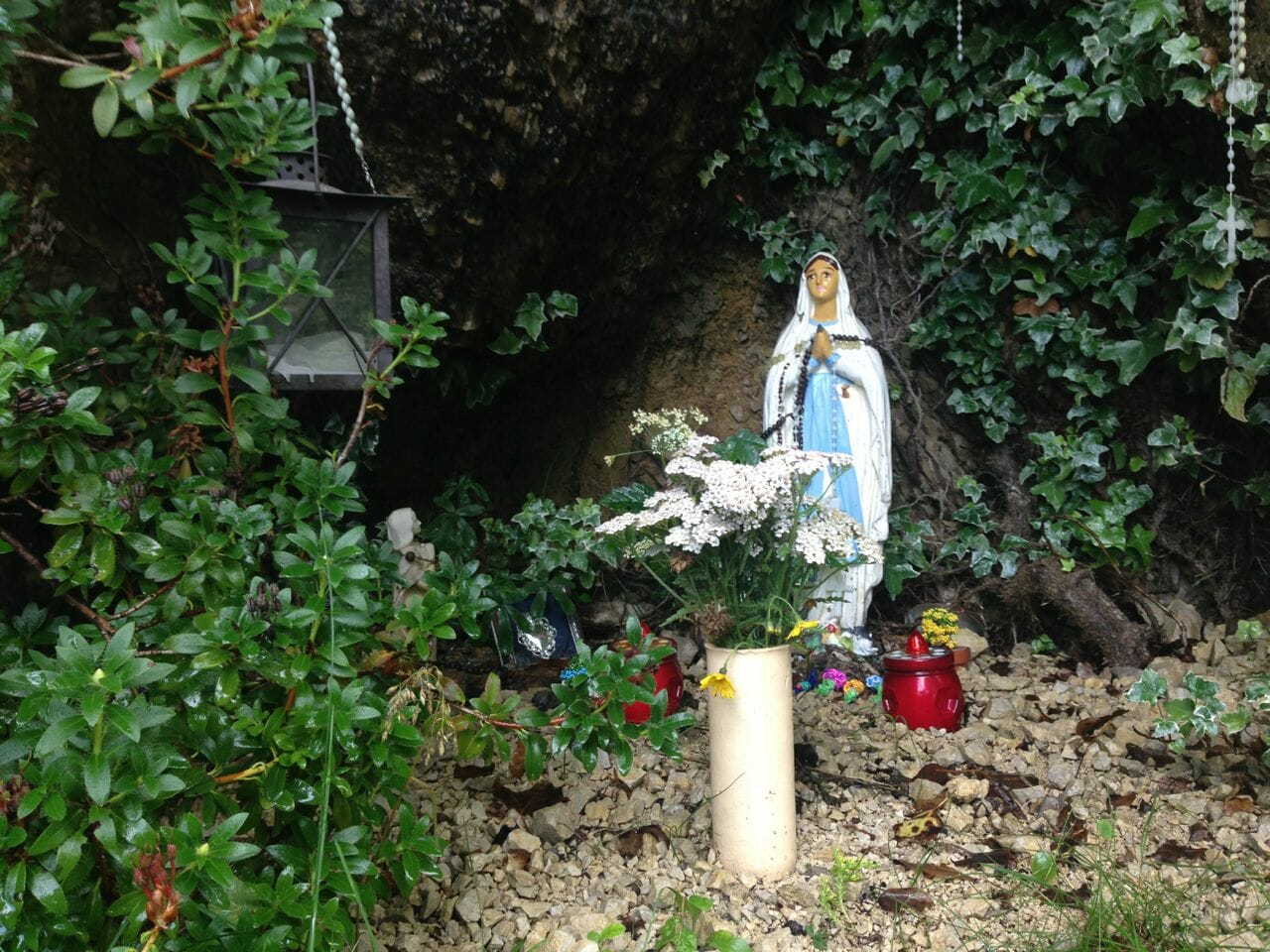 A shrine in the side of the mountain.