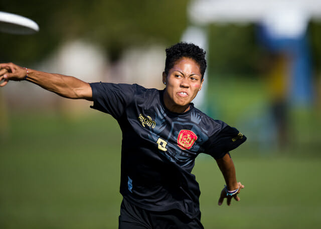 "Scandal's Octavia ""Opi"" Payne pulls the disc at WUCC 2014."