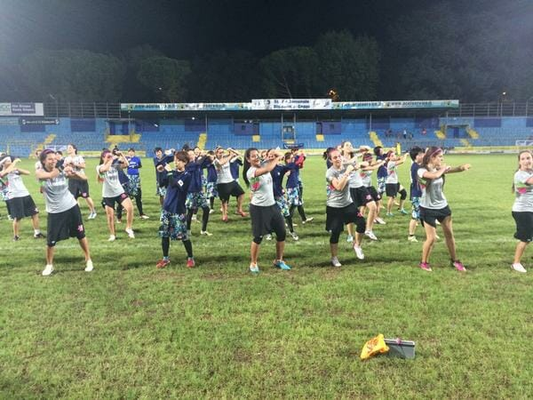 MUD and Revolution dance together after their game.