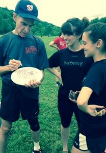 Bill Nye signing a disc for some Cornell Roses players.
