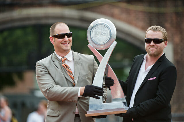 Jeff Snader (left) and Nic Darling presenting the MLU Championship trophy.