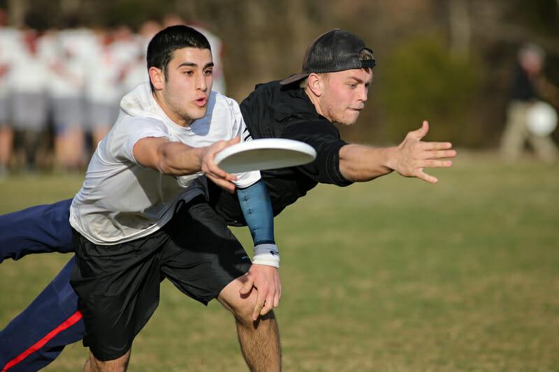 UMass' Ben Sadok makes the catch as Georgia's Elliott Erickson dives for the block.