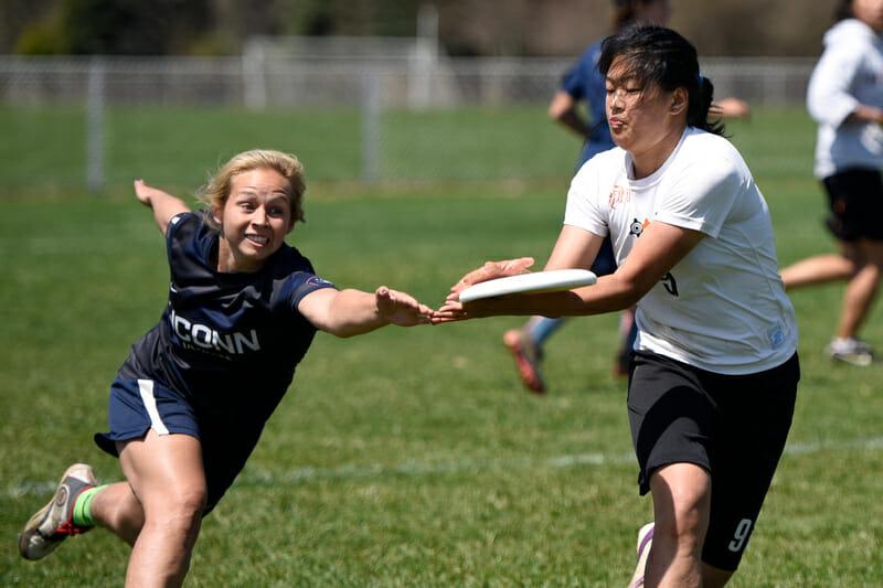 Princeton's Sheri Li hauls in a disc past a UConn defender at EME Conferences.