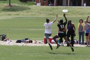 Wake Forest's Amanda Murphy and Elon's Sydney Harris vie for a disc in the AC DIII Regional Final