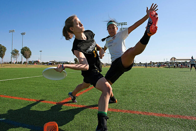 Molly Brown's Maggie Chen gets a foot block. Photo: Alex Fraser -- UltiPhotos.com
