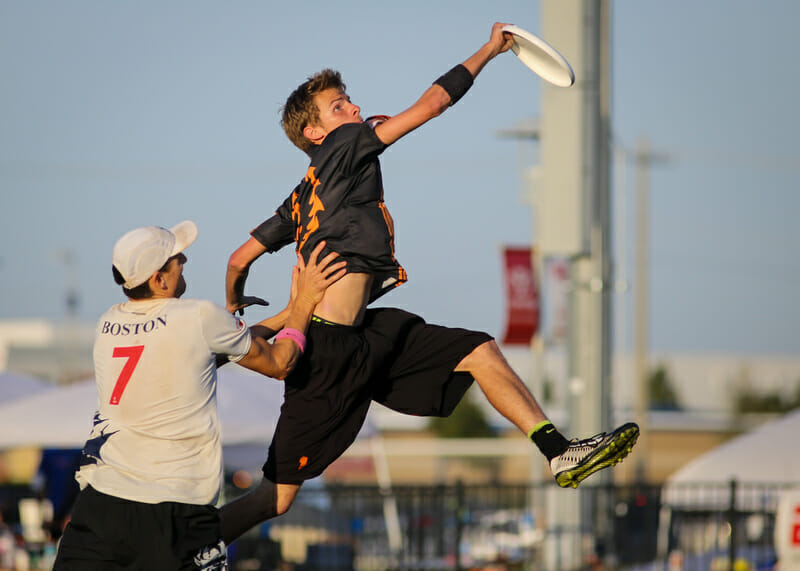 Ring of Fire's Justin Allen goes up for a grab at the 2014 Club Championships. Photo: Christina Schmidt -- UltiPhotos.com