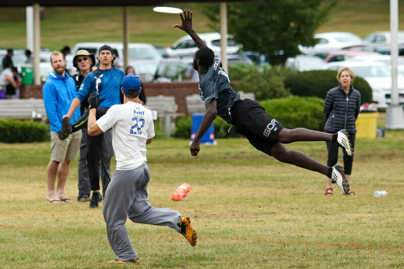Toronto GOAT's Remy Ojo flies for a block. Photo: Paul Rutherford -- UltiPhotos.com