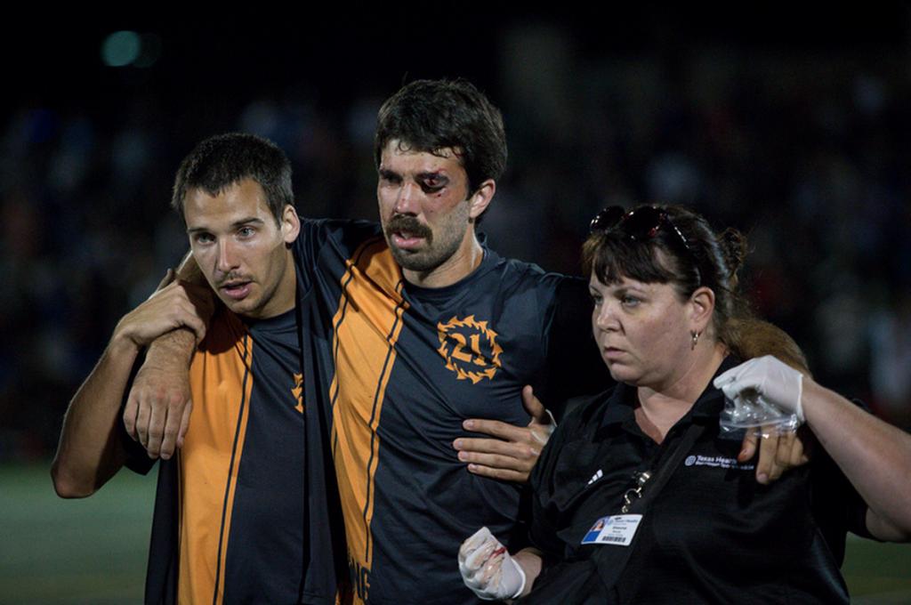 Jon Nethercutt comes off the field with an eye injury. Photo: Christina Schmidt -- UltiPhotos.com
