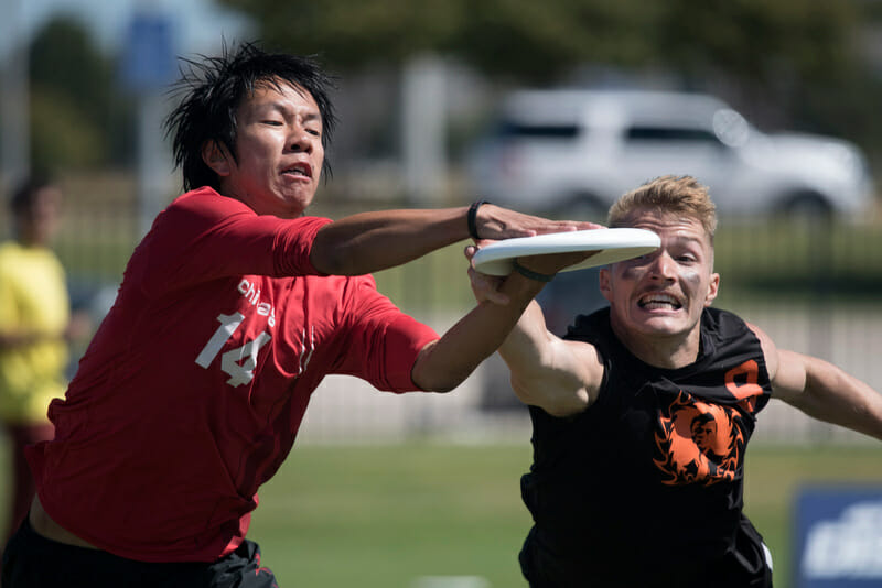 Machine's Bob Liu makes the catch in front of Ring's JD Hastings. Photo: Jolie Lang -- UltiPhotos.com