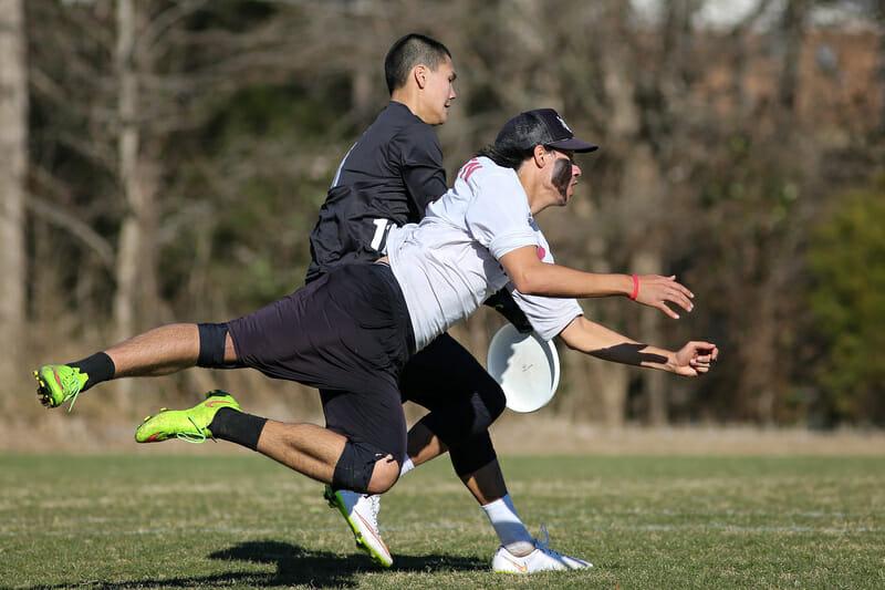 UMass' Conor Kline makes the catch past UNCW's Xavier Maxstadt. Photo: Christina Schmidt -- UltiPhotos.com