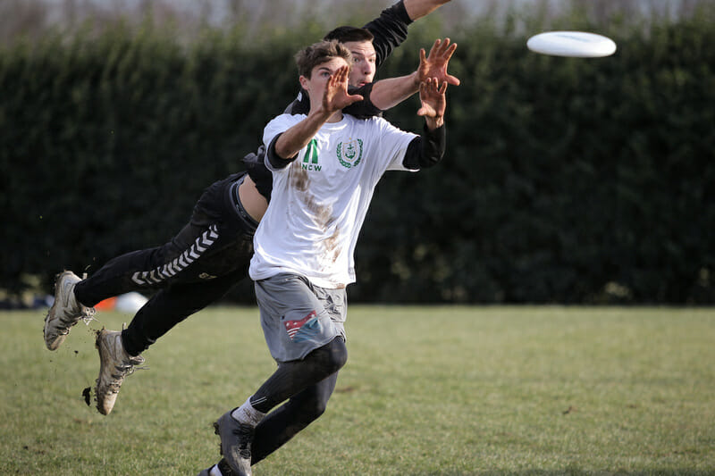 Jack Williams makes the catch under pressure from Jeff Babbitt. Photo: Christina Schmidt -- UltiPhotos.com
